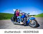 happy couple riding on blue... | Shutterstock . vector #483098368