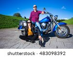 young couple posing with blue... | Shutterstock . vector #483098392