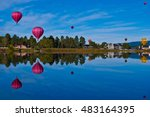 Hot air balloon festival in Pagosa Springs Colorado an amazing getaway on a mirror still lake reflecting colorful balloons all over the morning sky