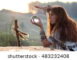 Witch With Crystal Ball At...