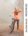 happy active woman riding bike... | Shutterstock . vector #483248182