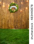 wooden wall and hop wreath with ... | Shutterstock . vector #483440878