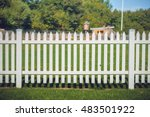 Small photo of Wooden fence in white color in the park