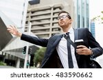 Young Businessman Hailing For ...