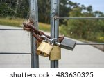 Close Up Of Four Padlocks On A...