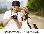 young asian couple tourists... | Shutterstock . vector #483764632