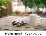 cup of hot coffee and newspaper ... | Shutterstock . vector #483764776