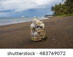 Seashells In Jar On The Sand...
