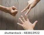 Closeup Of Hands Making Sign A...