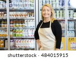 saleswoman with hand on hip... | Shutterstock . vector #484015915