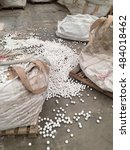 Small photo of Dirty big bag and white alumina ball on the floor.