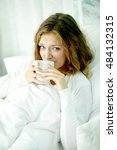unhappy woman lying in bed and... | Shutterstock . vector #484132315
