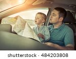 father and son looking on map... | Shutterstock . vector #484203808