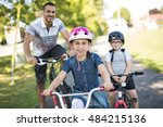 a dad with daughter son riding... | Shutterstock . vector #484215136