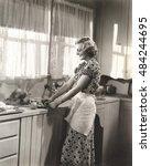 woman making homemade orange... | Shutterstock . vector #484244695