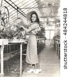 woman watering plants in... | Shutterstock . vector #484244818
