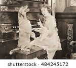 Dog Accompanying Woman On Piano