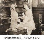 Small photo of Dog accompanying woman on piano