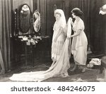 woman helping bride get dressed | Shutterstock . vector #484246075