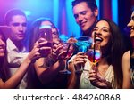 young friendly people toasting... | Shutterstock . vector #484260868