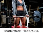 woman lifting weights in gym | Shutterstock . vector #484276216