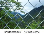 Wire Fence Focus With Mountain...