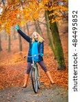 happy active woman riding bike... | Shutterstock . vector #484495852