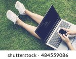 hands using laptop and... | Shutterstock . vector #484559086