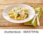 plate of italian penne pasta... | Shutterstock . vector #484575946