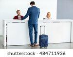 kind female receptionist wish... | Shutterstock . vector #484711936