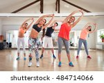 stretching exercises in gym | Shutterstock . vector #484714066