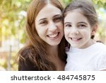 happy mother and girl | Shutterstock . vector #484745875
