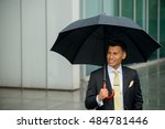 smiling businessman holding... | Shutterstock . vector #484781446