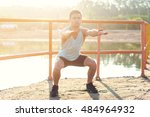fit man working out glutes with ... | Shutterstock . vector #484964932