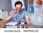 positive engineer testing robot | Shutterstock . vector #484966132