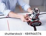 Small Humanlike Robot Holding...