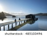 people sitting on boat sheds in ... | Shutterstock . vector #485103496