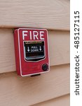 red fire switch on wooden wall | Shutterstock . vector #485127115
