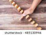close up hand stop woonen block....   Shutterstock . vector #485130946