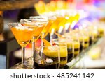 cocktail and cake | Shutterstock . vector #485241142
