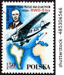 "Small photo of POLAND - CIRCA 1978: A stamp printed in Poland from the ""Aviation History and 50th Anniversary of Polish Aero Club"" issue shows Stanislaw Skarzynski and RWD-5 bis monoplane, circa 1978."