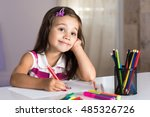 Little Girl Is Dreaming and  Drawing Pictures - stock photo