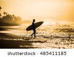 A Unrecognizable Surfer On An...