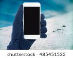 hand with fleece glove holding... | Shutterstock . vector #485451532