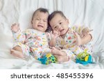 asia twin baby lying on a white ... | Shutterstock . vector #485455396