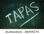 tapas written with a chalk on a blackboard - stock photo