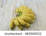 ripe yellow banana on wooden...   Shutterstock . vector #485500522