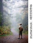 man walking in a foggy summer... | Shutterstock . vector #485550946