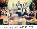 two smiling workers selling... | Shutterstock . vector #485581822