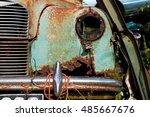 rusty old car in a scrap yard.... | Shutterstock . vector #485667676